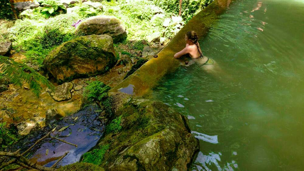 Girl in thermal pool in Sao Miguel